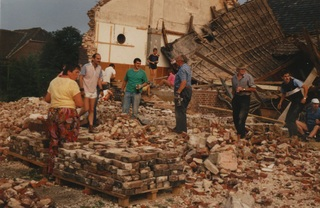 Demolition work, 1990. Bricks were carefully removed and stacked by numerous volunteer helpers