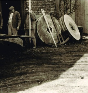 Removal of the grinding stones. Pictured is Gerhard Stammen, the last Miller in Wemb who operated the windmill until 1960